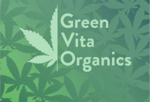 Logo Green Vita Organics mit Cannabis Blättern im Hintergrund